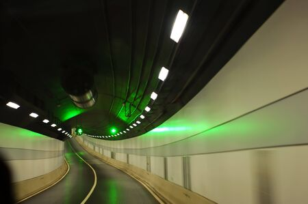 curved road in tunnel photo