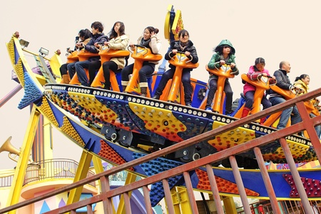 CHENGDU - FEB 3: Happy people play in the amusement park on Feb 3, 2011 in Chengdu, China. Stock Photo - 9205297