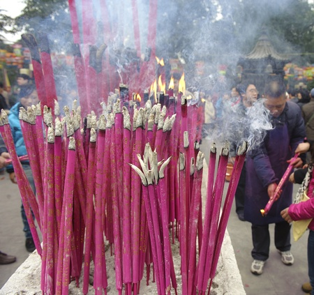 CHENGDU - FEB 5: People burning incense upon the incense altar in temple during chinese new year on Feb 5, 2011 in Chengdu, China.Many people want to relieve their worries and difficulties by burning incense and praying to Buddha during festivals.Its par