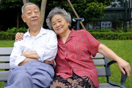an intimate senior couple embraced photo