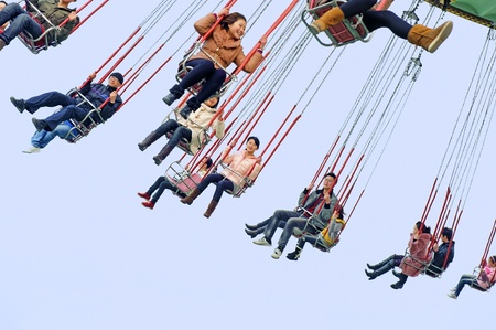 chairoplane: CHENGDU - FEB 3: Happy people play in the amusement park on Feb 3, 2011 in Chengdu, China. Editorial
