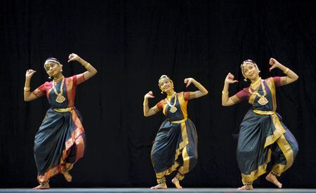 actress girl: CHENGDU,CHINA - OCT 24: Indian folk dance performed by Kalakshetra dance institute of India at JINCHENG theater during the festival of India in China.Oct 24,2010 in Chengdu, China. Editorial
