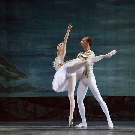 swan pair: CHENGDU,CHINA - DECEMBER 24: Russian royal ballet perform Swan Lake ballet at Jinsha theater December 24, 2008 in Chengdu, China. Editorial
