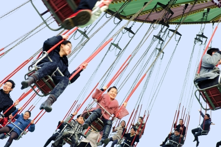 CHENGDU - FEB 3: Happy people play in the amusement park on Feb 3, 2011 in Chengdu, China. Stock Photo - 9256485