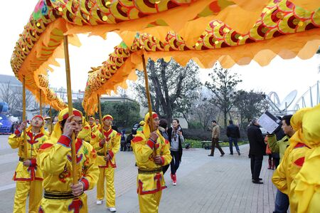 traditional custom: CHENGDU - FEB 3: People playing dragon dances to celebrate festivals during chinese new year on Feb 3, 2011 in Chengdu, China.Dragon dances during festivals are part of the traditional custom in China.