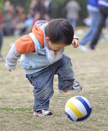 children sport: baby playing football