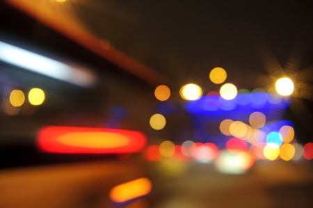 High-speed vehicles blurred trails on urban roads Stock Photo