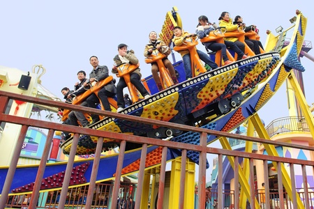 CHENGDU - FEB 3: Happy people play in the amusement park on Feb 3, 2011 in Chengdu, China. Stock Photo - 9286707