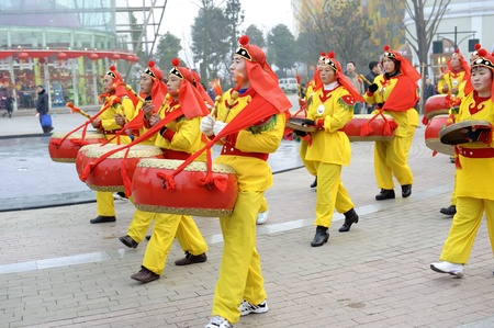 traditional custom: CHENGDU - FEB 3: People playing drums and gongs to celebrate festivals during chinese new year on Feb 3, 2011 in Chengdu, China.Playing drums and gongs during festivals are part of the traditional custom in Chengdu,China.