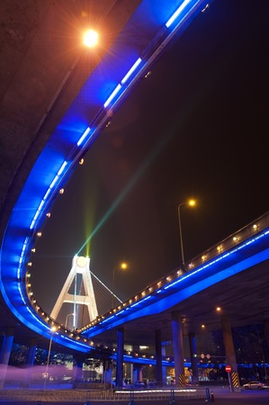 bright lights under urban overpass photo