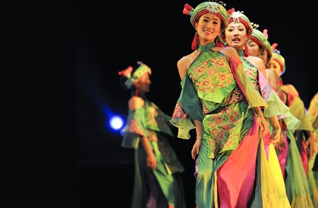 leidenschaft: CHENGDU - SEP 28: chinese Qiang ethnic dancers perform on stage at Sichuan experimental theater.Sep 28,2010 in Chengdu, China.
