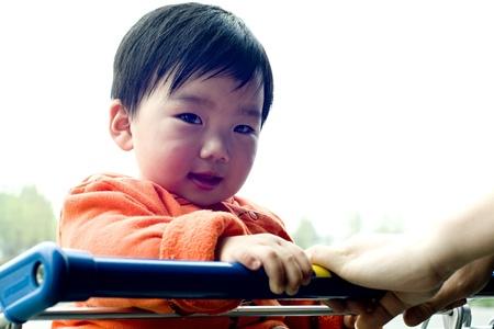 bashful: the cute baby is bashful. Stock Photo