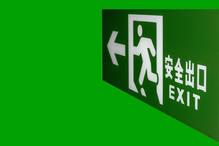 emergency exit sign shine bright green light Stock Photo - 9329887