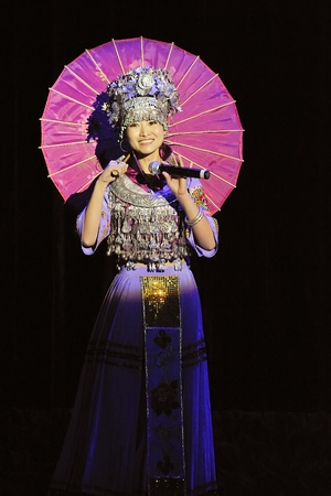 leidenschaft: CHENGDU - SEP 28: chinese Miao ethnic singer performs on stage in the 6th Sichuan minority nationality culture festival at JINJIANG theater.Sep 28,2010 in Chengdu, China.