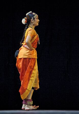 CHENGDU, CHINA - OCT 24,2010: Indian dancer performs folk dance at JINCHENG theater during the festival of India in china.Oct 24,2010 in Chengdu, China.