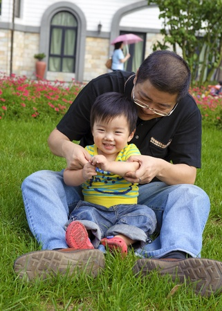 happy baby is playing with his father Stock Photo - 9361247