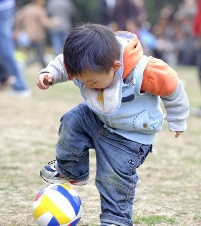 baby playing football photo