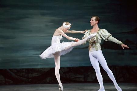 swan pair: CHENGDU - DECEMBER 24: Russian royal ballet perform Swan Lake ballet at Jinsha theater December 24, 2008 in Chengdu, China.