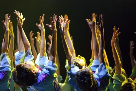 CHENGDU - DEC 10: chinese modern dancers perform group dance on stage at Golden theater.Dec 10,2007 in Chengdu, China.Choreographer: Li Chunyan, etc., actor: 20