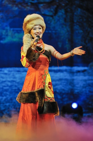 CHENGDU - SEP 28: chinese Tibetan ethnic folk singer performs on stage at experimental theater.Sep 28,2010 in Chengdu, China.