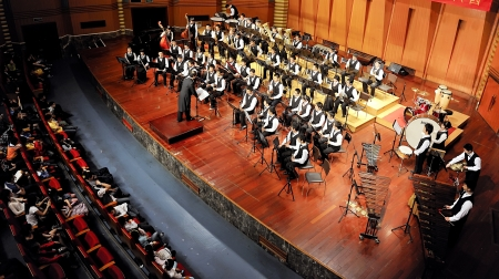 CHENGDU - APR 23: student symphonic band perform on stage on Apr 24,2011 in Chengdu,China.