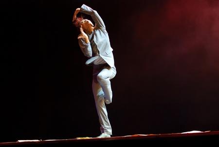 rui: CHENGDU - DEC 11: chinese dancer performs modern solo dance on stage at JINCHENG theater.Dec 11,2007 in Chengdu, China. Choreographer: Xiao Xiangrong, Chang Xiaoni, Cast: Sun Rui