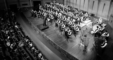 symphonic: CHENGDU - APR 23: student symphonic band perform on stage on Apr 24,2011 in Chengdu,China.