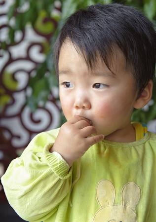 a cute baby is eating in restaurant photo