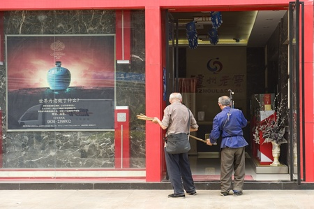 mendicant: CHENGDU - MAY 7: Blind beggars begging in front of store on May 7, 2011 in Chengdu, China.