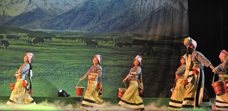 CHENGDU - JAN 20: Tibetan ethnic dancers perform folk dance drama onstage at JinJing theater on Jan 20, 2010 in Chengdu, China.