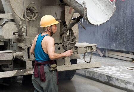laborer: hardworking laborer on construction site Stock Photo