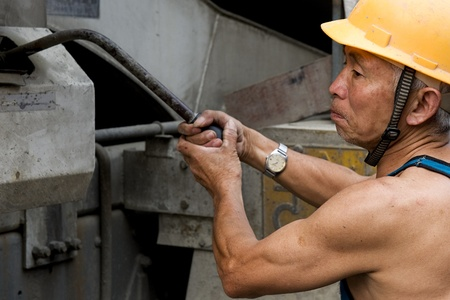 hardworking laborer on construction site Stock Photo