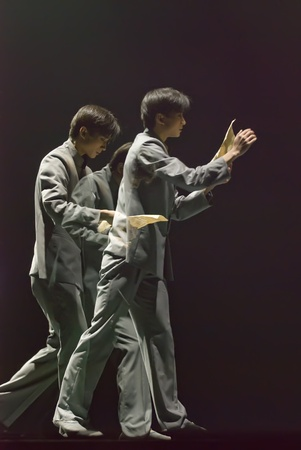 CHENGDU - DEC 20: professional modern dancer performs solo dance on stage at JINCHENG theater.Dec 20, 2007 in Chengdu, China.Choreographer: Xiao Xiangrong, Chang Xiaoni, Cast: Sun Rui Stock Photo - 9690507