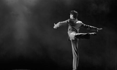 CHENGDU - DEC 11: professional modern dancer performs solo dance on stage at JINCHENG theater.Dec 11, 2007 in Chengdu, China.Choreographer: Xiao Xiangrong, Chang Xiaoni, Cast: Sun Rui Stock Photo - 9690512