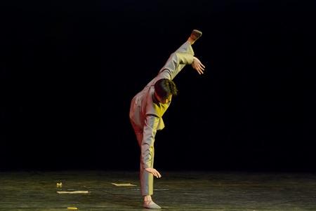 CHENGDU - DEC 15: professional modern dancer performs solo dance on stage at JINCHENG theater.Dec 15, 2007 in Chengdu, China.Choreographer: Xiao Xiangrong, Chang Xiaoni, Cast: Sun Rui Stock Photo - 9690508