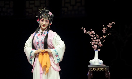 CHENGDU - MAY 28: chinese Sichuan opera performer make a show on stage to compete for awards at Jinsha theater in 25th Chinese Drama Plum Blossom Award competition.May 28, 2011 in Chengdu, China. Chinese Drama Plum Blossom Award is the highest theatrical