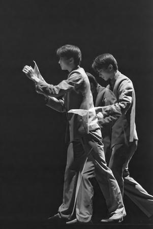 rui: CHENGDU - DEC 20: professional modern dancer performs solo dance on stage at JINCHENG theater.Dec 20, 2007 in Chengdu, China. Choreographer: Xiao Xiangrong, Chang Xiaoni, Cast: Sun Rui