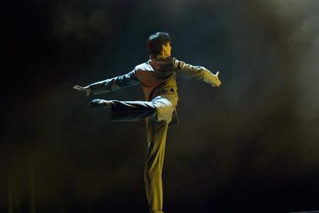 CHENGDU - DEC 11: professional modern dancer performs solo dance on stage at JINCHENG theater.Dec 11, 2007 in Chengdu, China.Choreographer: Xiao Xiangrong, Chang Xiaoni, Cast: Sun Rui Stock Photo - 9735247
