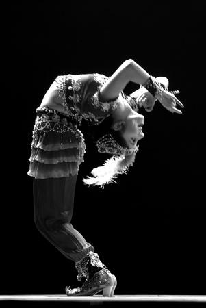 CHENGDU - DEC 10: Chinese Uighur dancer performs folk dance\ onstage at JINCHENG theater.Dec 10,2007 in Chengdu, China.\
