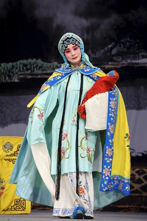 CHENGDU - MAY 30: chinese Beijing opera performer make a show on stage to compete for awards at Shengge theater in 25th Chinese Drama Plum Blossom Award competition.May 30, 2011 in Chengdu, China. Chinese Drama Plum Blossom Award is the highest theatrical