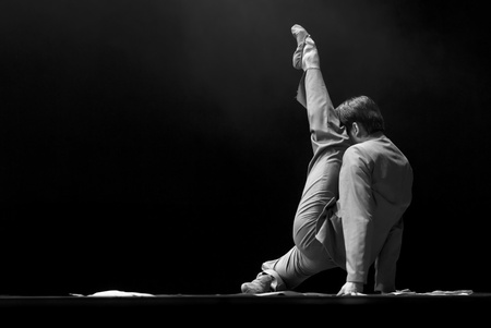 rui: CHENGDU - DEC 11: professional modern dancer performs solo dance on stage at JINCHENG theater.Dec 11, 2007 in Chengdu, China. Choreographer: Xiao Xiangrong, Chang Xiaoni, Cast: Sun Rui