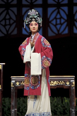 finery: CHENGDU - MAY 28: chinese Sichuan opera performer make a show on stage to compete for awards at Jinsha theater in 25th Chinese Drama Plum Blossom Award competition.May 28, 2011 in Chengdu, China. Chinese Drama Plum Blossom Award is the highest theatrical  Editorial