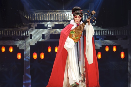 CHENGDU - JUN 4: chinese Sichuan opera performer make a show on stage to compete for awards in 25th Chinese Drama Plum Blossom Award competition at Xinan theater.Jun 4, 2011 in Chengdu, China.Chinese Drama Plum Blossom Award is the highest theatrical awa Stock Photo - 9907272