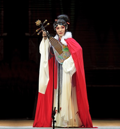 CHENGDU - JUN 4: chinese Sichuan opera performer make a show on stage to compete for awards in 25th Chinese Drama Plum Blossom Award competition at Xinan theater.Jun 4, 2011 in Chengdu, China. Chinese Drama Plum Blossom Award is the highest theatrical awa
