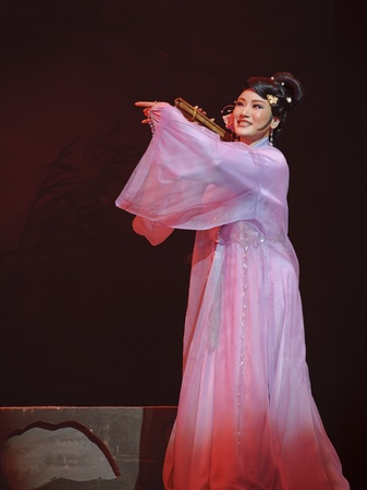 CHENGDU - MAY 31: chinese Yue opera performer make a show on stage to compete for awards in 25th Chinese Drama Plum Blossom Award competition at Experimental theater.May 31, 2011 in Chengdu, China.Chinese Drama Plum Blossom Award is the highest theatrical