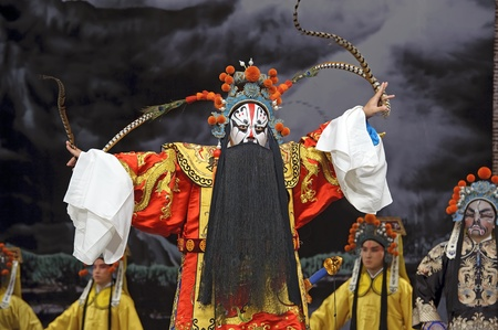 exaggerate: chinese traditional opera actor with theatrical costume and facial painting Stock Photo
