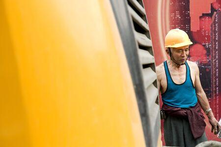 hardworking laborer on construction site photo