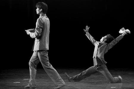 rui: CHENGDU - DEC 15: professional modern dancer performs solo dance on stage at JINCHENG theater.Dec 15, 2007 in Chengdu, China. Choreographer: Xiao Xiangrong, Chang Xiaoni, Cast: Sun Rui Editorial