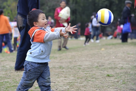 kickball: baby playing football