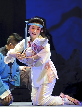 customary: CHENGDU - JUN 8: Chinese Chu opera performer make a show on stage to compete for awards in 25th Chinese Drama Plum Blossom Award competition at Experimental theater.Jun 8, 2011 in Chengdu, China. Chinese Drama Plum Blossom Award is the highest theatrical  Editorial